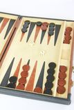 Game backgammon on a board with dices and checkers. Game backgammon on board with dices and checkers royalty free stock photo