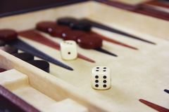 Game backgammon on a board with dices and checkers. Game backgammon on board with dices and checkers stock photos