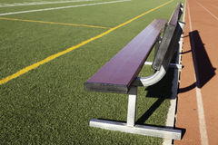 Game Bench. An empty bench on the sidelines Royalty Free Stock Photography