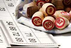 The game of bingo  - cards and barrels Royalty Free Stock Photo