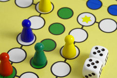 Game on board. And dice Royalty Free Stock Photography