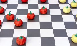 Game board with checkers in the form of orange and yellow pumpkins stock images
