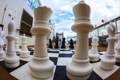The Game. ON BOARD OF CRUISE SHIP N.C.L. DAWN JAN 26 2016: Chessboard and chess pieces on the deck Stock Image