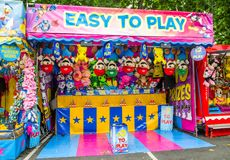 Free Game Booth Winning Prizes For Dolls At Community Fun Fair. Royalty Free Stock Photography - 123510667