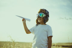 Game, Boy playing to be airplane pilot, funny guy with aviator c Stock Image