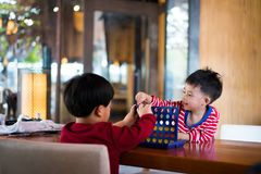 Game. Brothers are playing a game together Royalty Free Stock Image