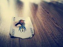Burned joker card royalty free stock photos