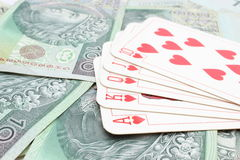 Game card on heap of banknotes Royalty Free Stock Photos