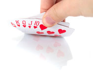 Game cards. And hand on white Royalty Free Stock Photos