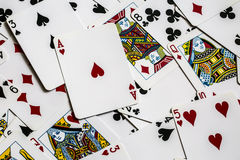 Game Cards. Deck of playing card spread out on a table Stock Image