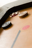 A game of carrom close to victory Royalty Free Stock Photography