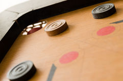 A game of carrom close to victory Stock Photos