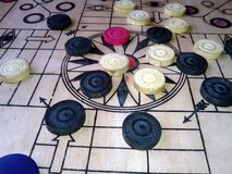 A game of carrom with pieces carrom man on the board carom - stacking. Play royalty free stock photo