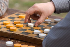 Game in checkers Stock Images