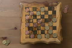 Game of checkers - US cents VS eurocents Royalty Free Stock Image