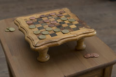 Game of checkers - US cents VS eurocents Royalty Free Stock Photography