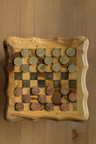 Game of checkers - US cents VS eurocents Royalty Free Stock Images