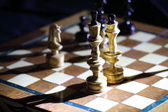 Game in chess. The queen protects the king in chess game Stock Photography