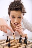 Game chess. Young chess player losing a game royalty free stock images