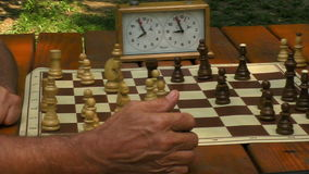 Game of chess. Active retired people, two senior men playing chess at park stock video footage