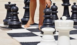 Game in chess on a beach Stock Image