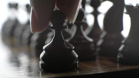 Game of chess, the silhouette figures on a white background.