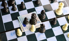 The game of chess and the European currency Royalty Free Stock Photo
