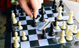 The game of chess and the European currency Stock Photos