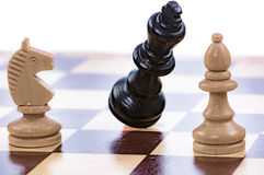 Game of chess with a falling king Stock Photography