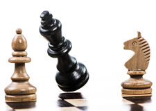 Game of chess with a falling king Royalty Free Stock Images
