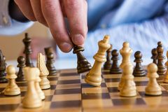 Game of chess. King falling in defeat Stock Photography