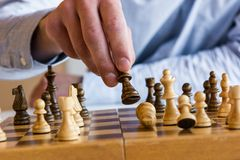 Game of chess. King falling in defeat Stock Image