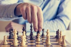 Game of chess. Man making a move Stock Photos