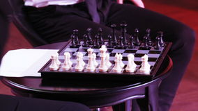 Game of chess by men. The hands of men play chess stock video footage