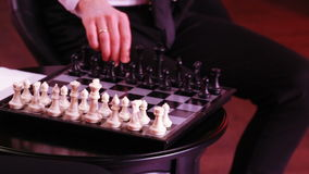 Game of chess by men. The hands of men play chess stock footage