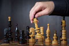 Game in chess. The chess player makes the move Royalty Free Stock Photos