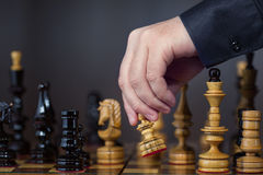 Game in chess. The chess player makes the move Stock Photo