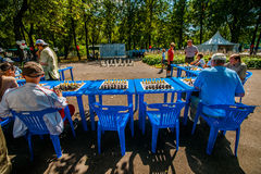 The game of chess and simultaneous chess display Royalty Free Stock Images