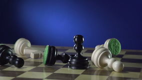 Game of chess white king affects black king chess player and the visible hand stock video
