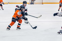 Game between children ice-hockey teams Stock Images