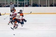 Game between children ice-hockey teams Stock Photo