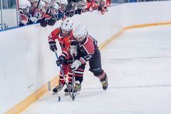 Game of children ice-hockey teams Royalty Free Stock Images