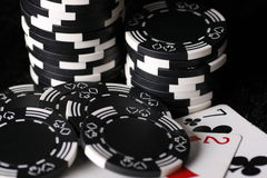 Game chips and worst possible poker hand. Close up on game chips with the worst possible poker hand, seven and two. Common used in poker games and other card Stock Images