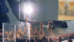 Game close-up view between chess player and robot. 4K