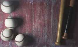Game concept. Top view of baseballs and bats on aged red wood surface with copy space. Game concept. 3D Rendering Royalty Free Stock Photography