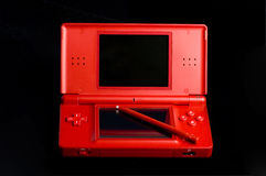 Game console. A red game console on a black background Stock Images