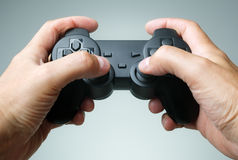 Game console controller. Video game console controller in gamer hands Royalty Free Stock Images