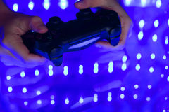 Game console in hand Stock Image
