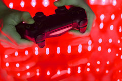 Game console in hand Royalty Free Stock Photography