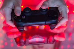 Game console in hands Royalty Free Stock Photos